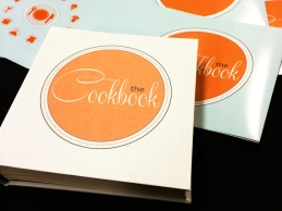Cookbook cover printed on cloth and had bound rests atop the full color dust jacket.