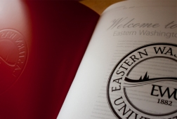 The University Seal placed on velum as an opening to the first pages and a mirror of the books cover.