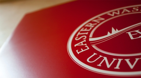 In keeping with a minimalistic yet impactful look and feel for this piece the University Seal is the only image present on the cover representing the schools colors of red and white.